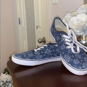 Blue and white slip on sneakers